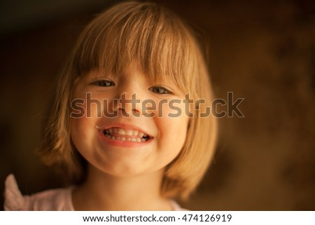 Cheerful smile of the lovely baby girl #474126919