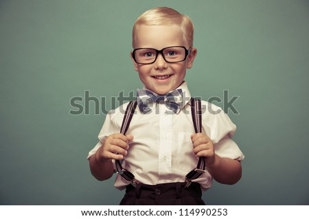 Cheerful smiling boy on a green background.