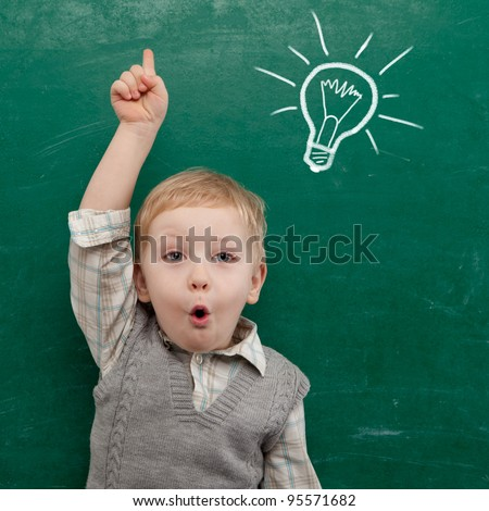 Shutterstock Cheerful smiling child at the blackboard. School concept