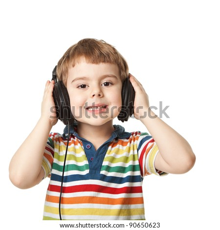 cheerful smiling little boy  listening to music in headphones. Isolated on white background.  shooting in the studio