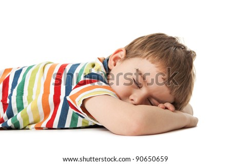 cheerful smiling little boy sleeps. Isolated on white background.  shooting in the studio