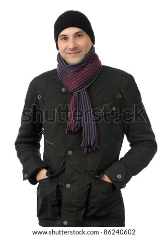 Cheerful smiling man in winter clothes isolated on white background