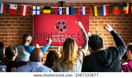 Cheerful supporters watching football at the pub #1087333877