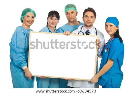 Cheerful team of five doctors holding a blank banner isolated on white background