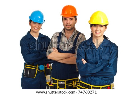 Cheerful team of three constructor workers standing with arms folded isolated on white background