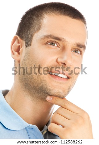 Cheerful thinking young man, isolated over white background