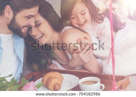Cheerful vibrant family enjoying happy moments #704582986