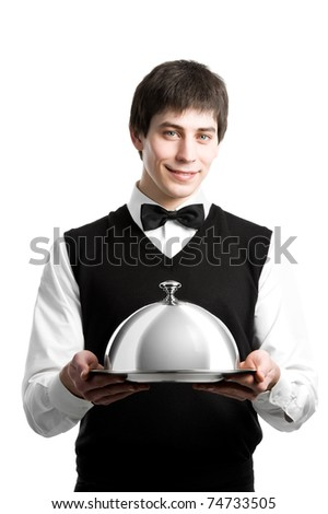 Cheerful waiter with metal cloche lid cover