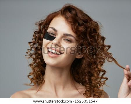 Cheerful woman curly hair health spa treatment treatment