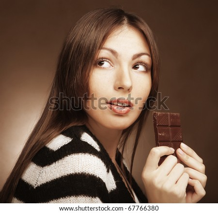 Cheerful woman eating chocolate