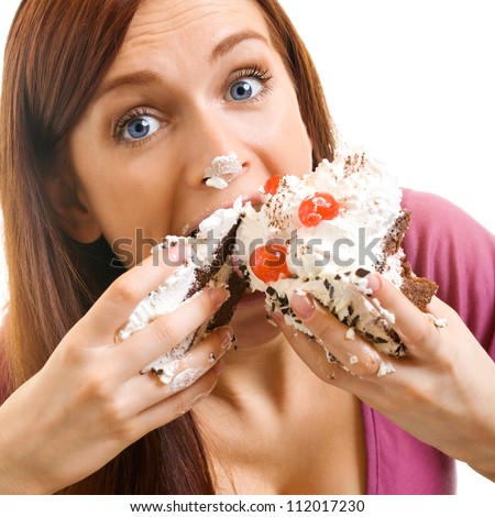 Cheerful woman eating pie, isolated over white background