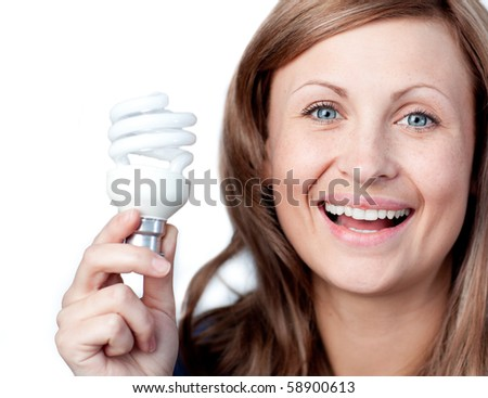 Cheerful woman holding a light bulb against white background