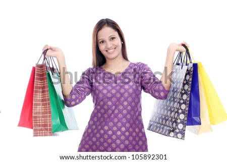 Cheerful woman holding shopping bags