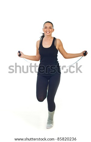 Cheerful woman in action leaping jump rope isolated on white background