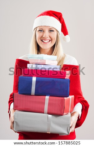 Cheerful woman is holding a lot of gifts and she is very happy about it,,It` time for presents!