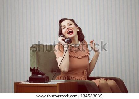cheerful woman talking on land...