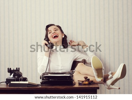 cheerful woman talking on phone ...