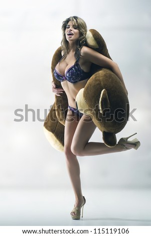 Cheerful woman with big teddy bear