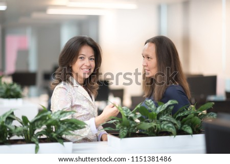 Cheerful women working in office.