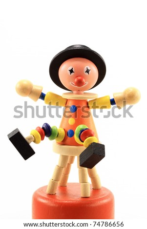 Cheerful wooden clown toy isolated on white background