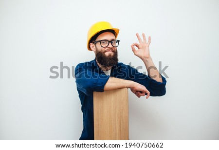 Cheerful worker - craftsman in work clothes with floor laminate in hands insulated on studio background. Collage in magazine style. Flyer with trendy colors, copyspace for ad. Your text here. Foto stock ©