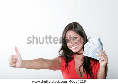 Cheerful young brunette lady holding cash and smiling
