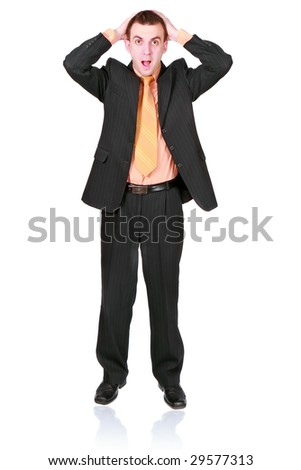 Cheerful young businessman hold a head  in horror condition. Isolated