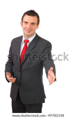Cheerful young businessman ready for handshake. Isolated