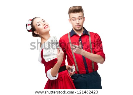 cheerful young caucasian couple in red vintage clothing holding money isolated on white - stock photo