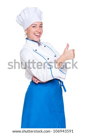 cheerful young cook showing thumbs up. isolated on white background