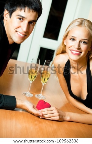Cheerful young couple and a special man proposal