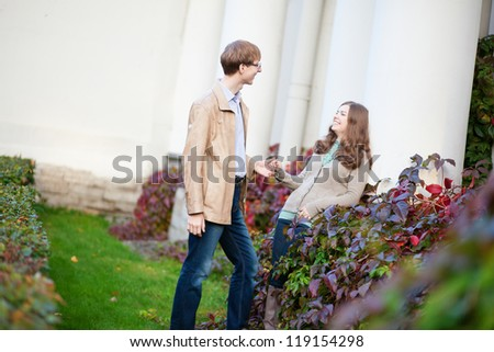Cheerful young couple having a date in park