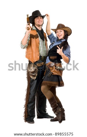 Cheerful young cowboy and cowgirl. Isolated on white