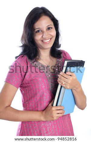 Cheerful young female student holding books