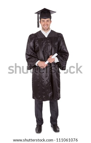 Cheerful young graduation man. Isolated on white