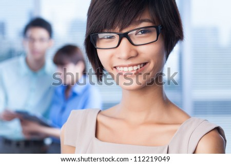 Cheerful young lady making her career in business