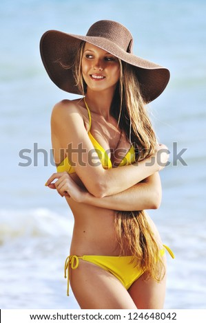 Cheerful young lady posing on vacation day - stock photo