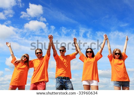 Cheerful young people having fun on a beach. Great summer holidays.
