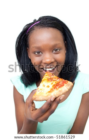 Cheerful young woman eating a pizza against a white background