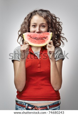 Cheerful Young Woman Holding Watermelon