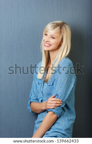 Cheerful young woman posing while looking at something