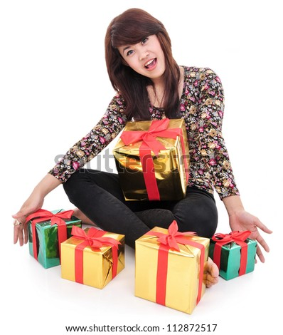 cheerful young woman with lots of gifts, isolated on white background