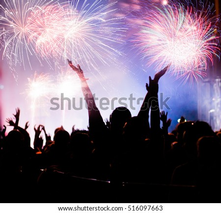 cheering crowd and fireworks - New Year celebration concept #516097663