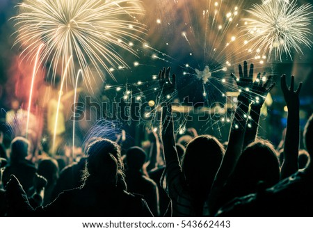 cheering crowd and fireworks - New Year concept #543662443
