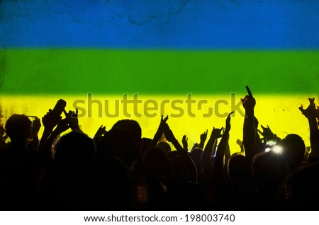 Cheering crowd and the colors of the Brazil flag - vintage photo