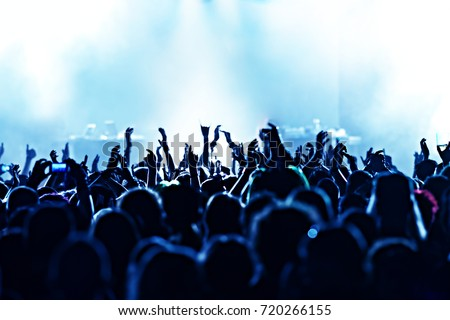 cheering crowd at a rock concert #720266155