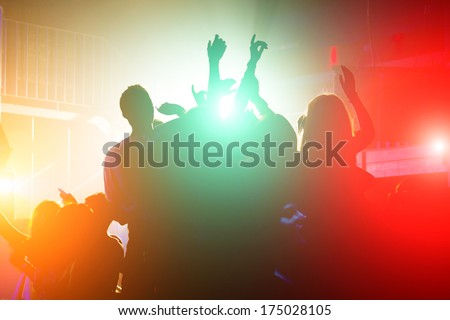 Cheering Crowd In Front Of Bright Stage Lights