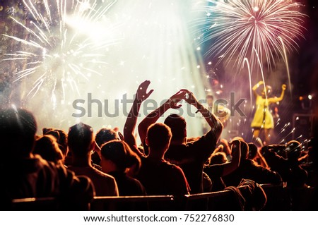 cheering crowd watching fireworks - new year concept #752276830