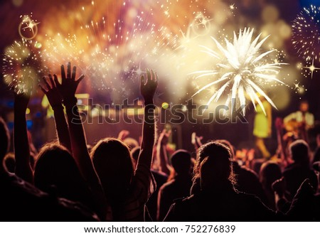 cheering crowd watching fireworks - new year concept #752276839