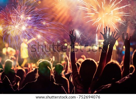 cheering crowd watching fireworks - new year concept #752694076